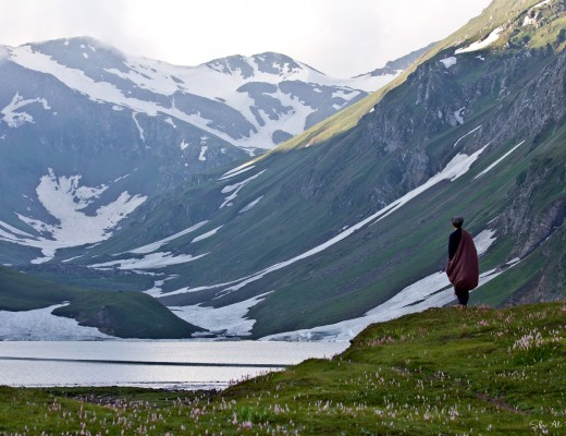 An explorer exploring the serene at Saral Lake