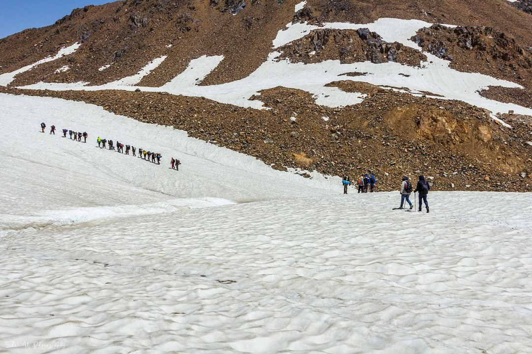 trekkers on the way to darkot pass top