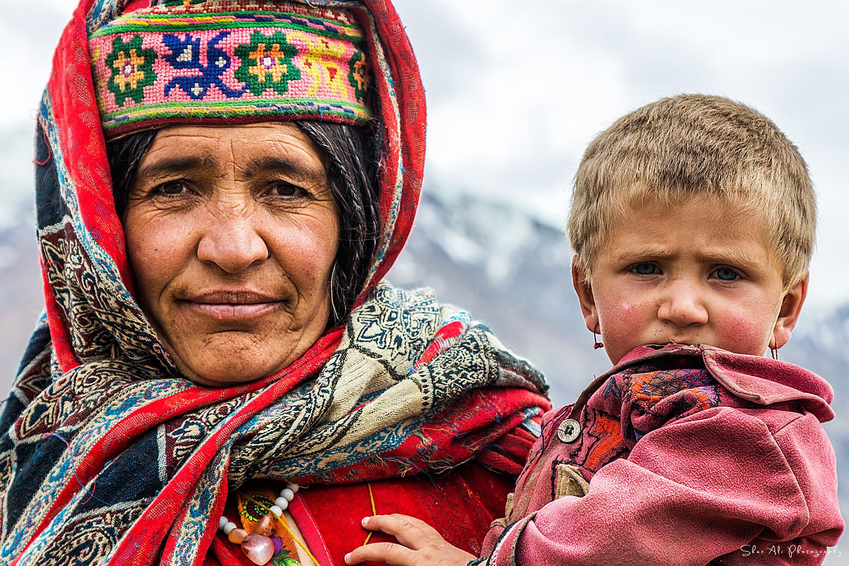 Wakhi woman and her baby from Broghil valley